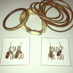 Bundle of gold shiny jewelry